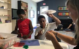 "Making windchimes during ""Let's Get Mov-ical!"" Week"